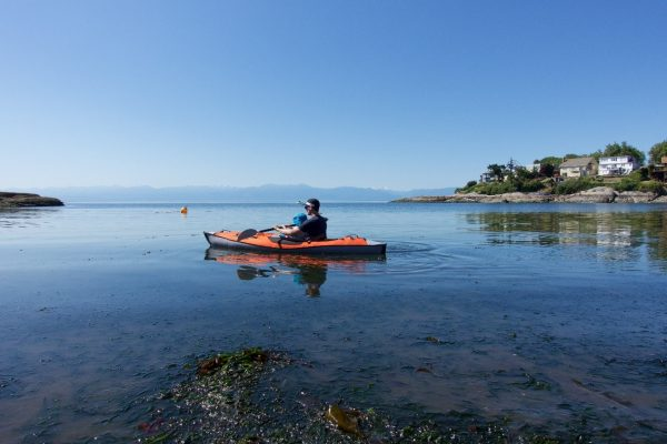 Man and toddler in a kayak on calm water